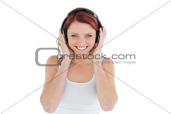 Beautiful casual woman enjoying music through headphones