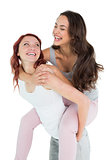 Happy young female piggybacking cheerful friend