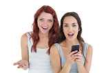 Shocked casual young female friends with mobile phone
