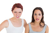 Close-up portrait of two angry young female friends
