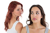 Unhappy young female friends not talking after argument
