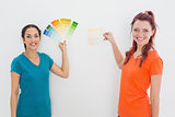 Friends choosing color for painting a room