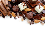 different varieties of chocolate and sweets on a white background