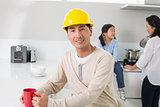 Man in hard hat with family in background at home