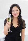 Portrait of a smiling young woman with champagne