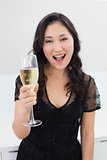 Portrait of a beautiful young woman with champagne