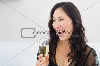 Beautiful young woman with champagne