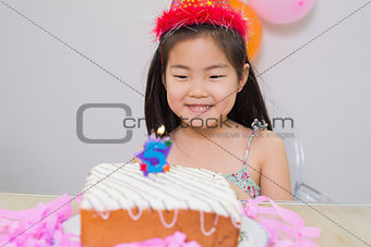Cute little girl looking at her birthday party