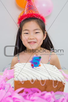 Smiling little girl at her birthday party