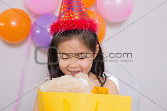 Little girl with gifts at her birthday party