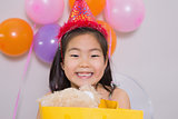Little girl with gift at her birthday party