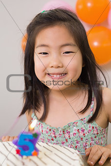 Cute little girl at her birthday party