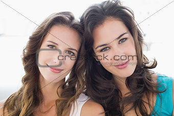 Close-up portrait of two smiling young female friends