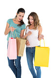 Two happy female friends looking into shopping bags