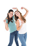 Two cheerful young female friends dancing