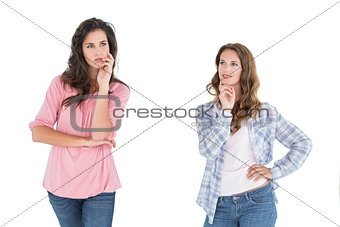 Two thoughtful casual young female friends
