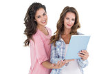 Two casual young female friends with digital tablet