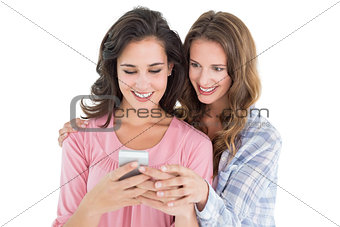 Female friends looking at mobile phone
