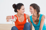 Two cheerful female friends with house keys
