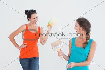 Friends with paint brush choosing color for painting a room