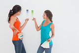 Side view of two female friends choosing color