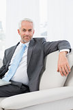 Relaxed mature businessman with laptop at home