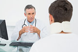 Doctor in conversation with patient at office