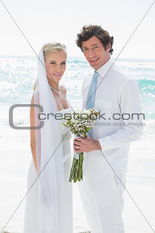 Bride and groom smiling at camera