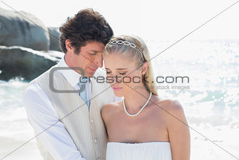 Peaceful bride and groom embracing