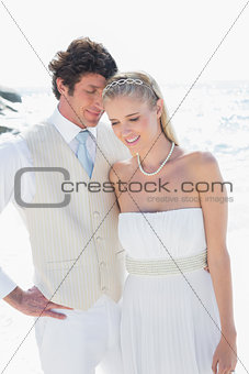 Attractive bride and groom embracing