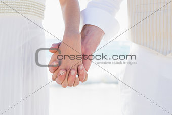 Newlyweds hand in hand