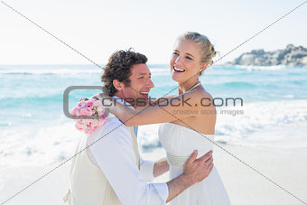 Groom picking up his pretty new wife