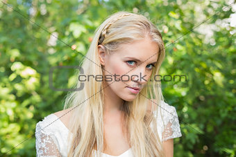 Blonde bride looking peacefully at camera