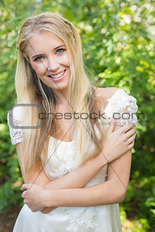 Blonde pretty bride smiling at camera