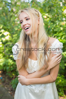 Blonde pretty bride laughing