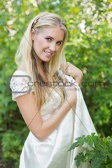 Smiling beautiful bride looking at camera