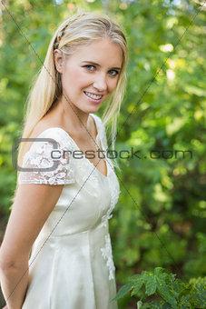 Smiling beautiful bride looking at the camera