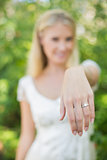 Blonde bride showing her diamond ring