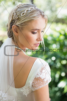 Blonde bride in a veil rear view