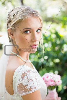 Blonde bride in a veil looking to camera