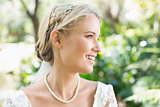 Happy blonde bride wearing pearls