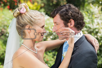 Groom looking at his pretty blonde wife