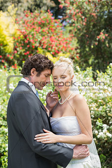 Romantic newlyweds embracing