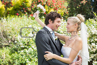 Romantic happy newlyweds embracing looking at each other