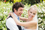 Romantic smiling newlywed couple hugging each other