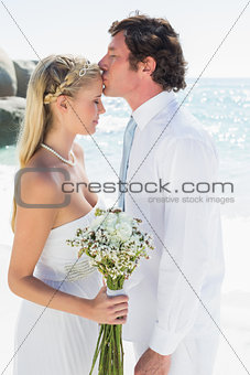 Affectionate couple on their wedding day