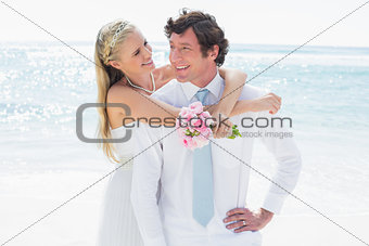 Cute couple on their wedding day smiling at each other