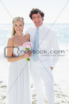 Cute happy couple on their wedding day smiling at camera