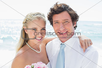 Cute cheerful couple on their wedding day
