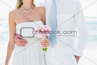 Couple embracing on their wedding day